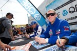 Josh signing autographs